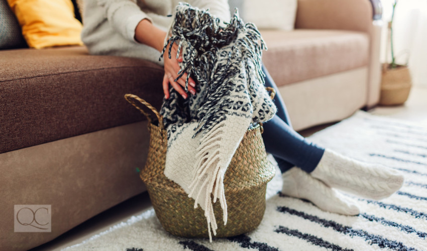 throw blanket in decorative basket for interior decor