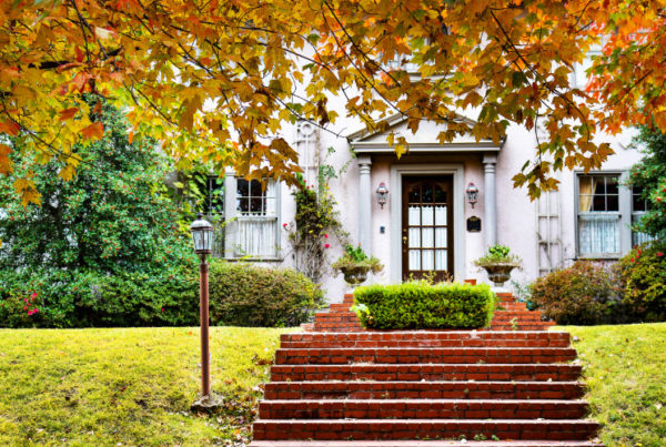 certified home stager creating curb appeal for home being sold in autumn