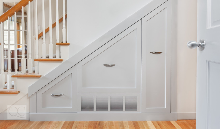 storage space built into the staircase as designed by a professional organizer
