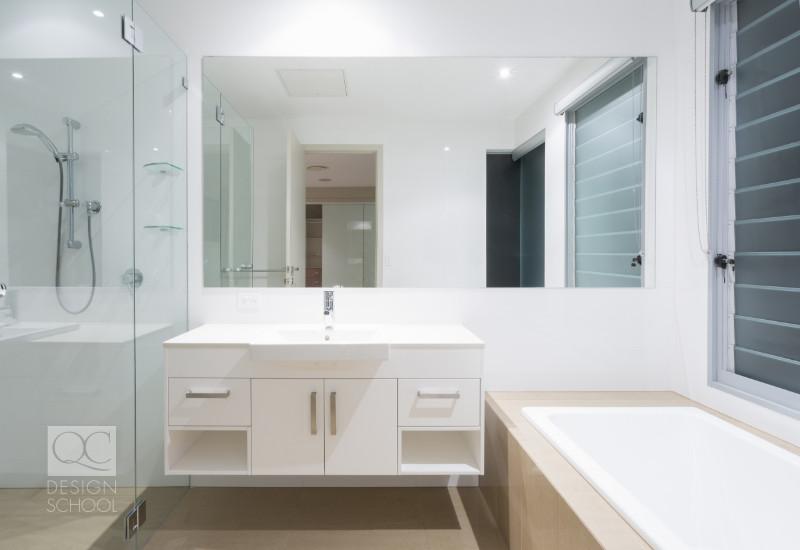 mirror in bathroom opens it up