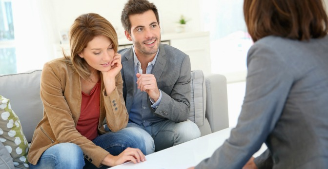 Couple meeting an interior decorator for a consultation