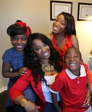 Jacqueline Forde with her children Ashantee, Rayne & Roger II