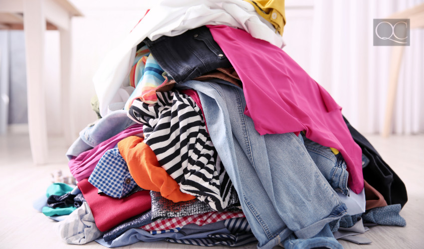 piles of clothes in decluttering process for konmari method