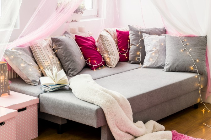 Decorative bedding and decorative pillows for decorating a student dorm room