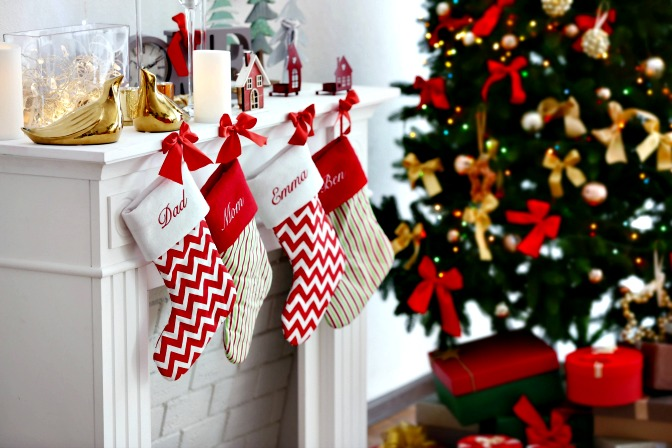 Decorating stockings to hang on the mantel for christmas decor