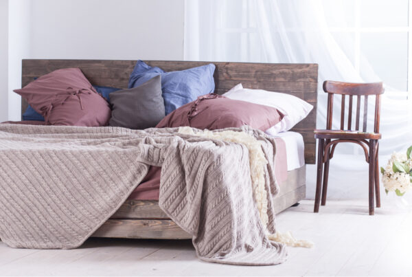 home staging sins messy bed and pillows