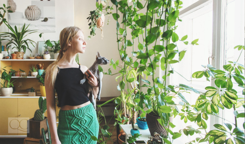 girl living in a home with lots of sunlight and plenty of plants