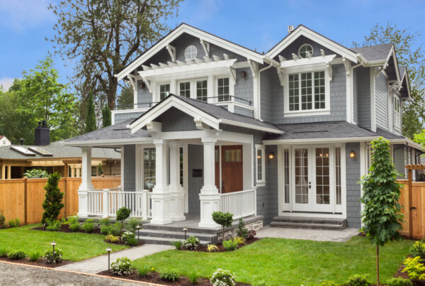 home stager creating curb appeal for home on sale