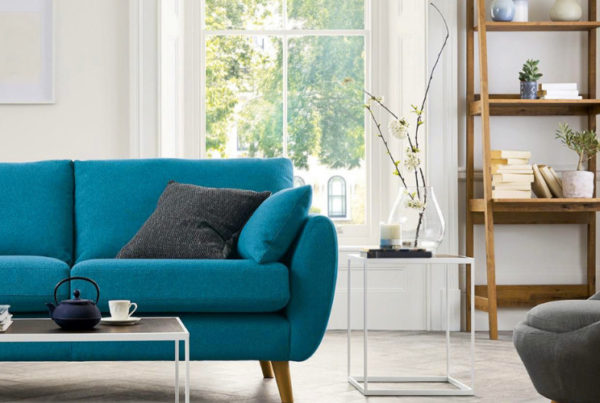 interior decorating certification tests aren't easy to pass without the proper training. Bright accent sofa against a living room