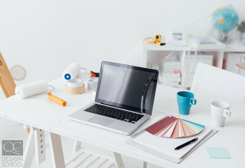 learning interior decorating online at a desk with laptop
