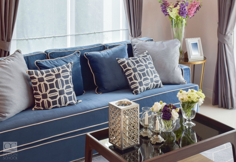 Denim blue sofa in neutral toned living room.