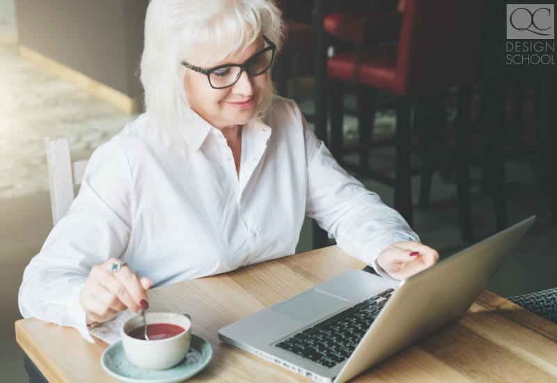 old woman studying home design online