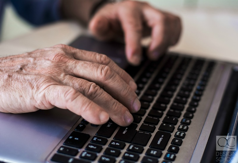 retired hands on a keyboard surfing the web