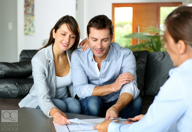 couple looking over professional interior designer's plans