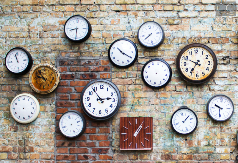 clocks on brick wall