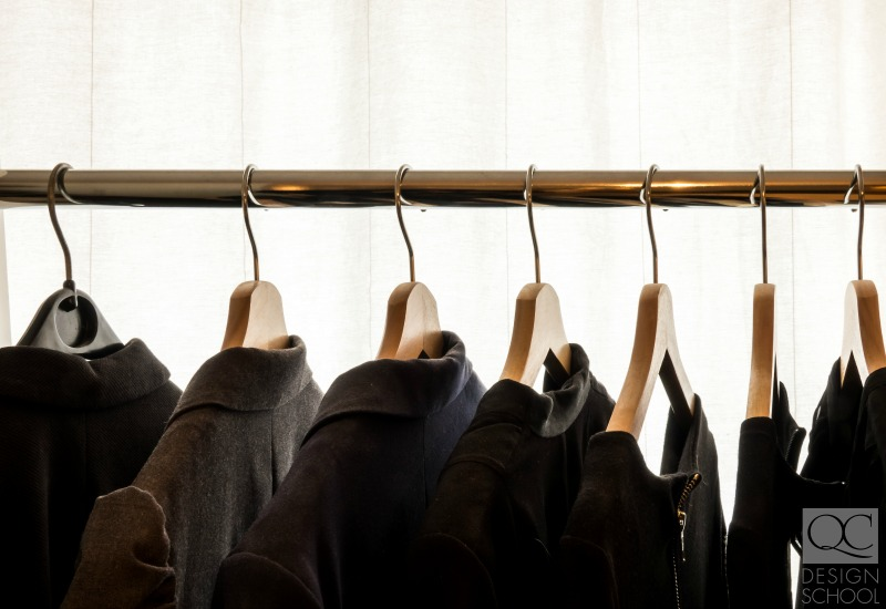 hanging black coats in a closet