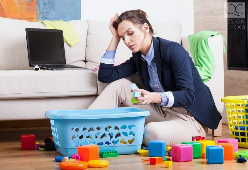 becoming a professional organizer busy mother cleaning up toys clutter in her living room