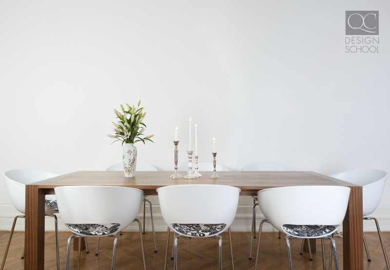 professionally staged table with white chairs