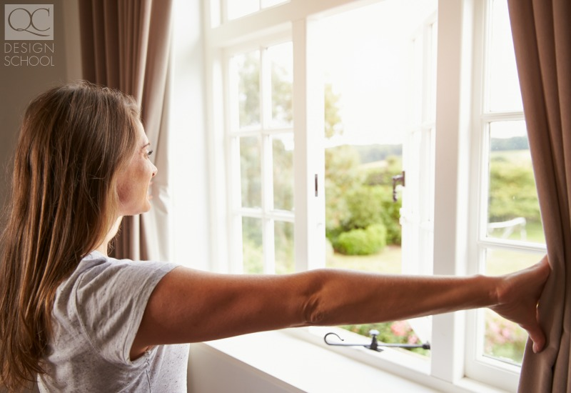 girl opening window for fresh air