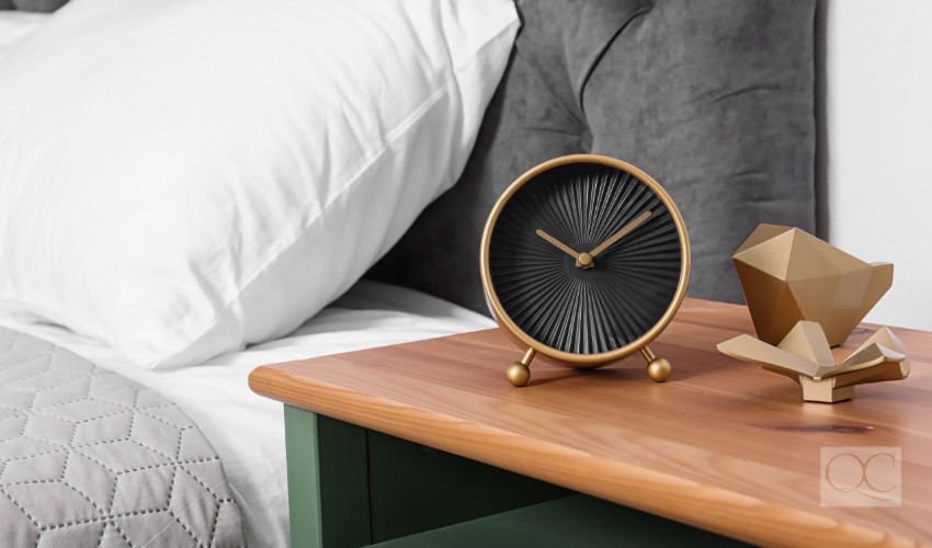 clock on nightstand for time management for new years resolution