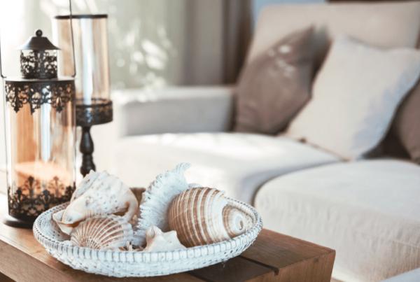 coffee table decor bowl of seashells and lamps
