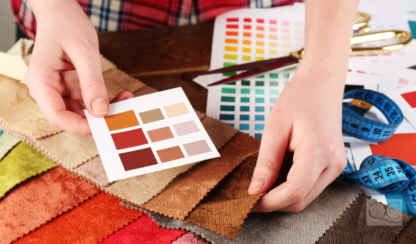 color consultant goes over color swatches for a decorating job