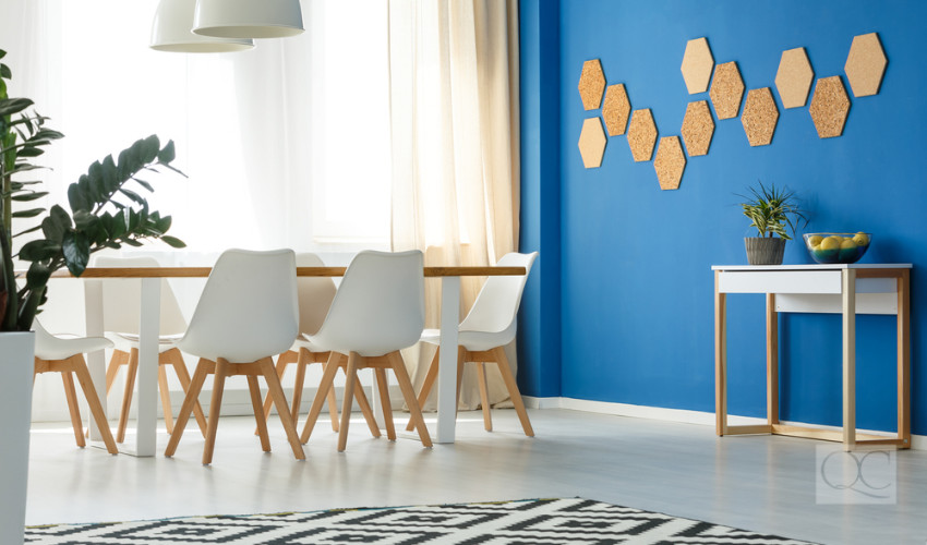 accent blue wall in sparsely decorating living space