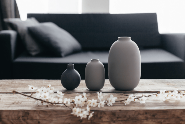 minimalistic grey and black pot decor on wooden coffee table