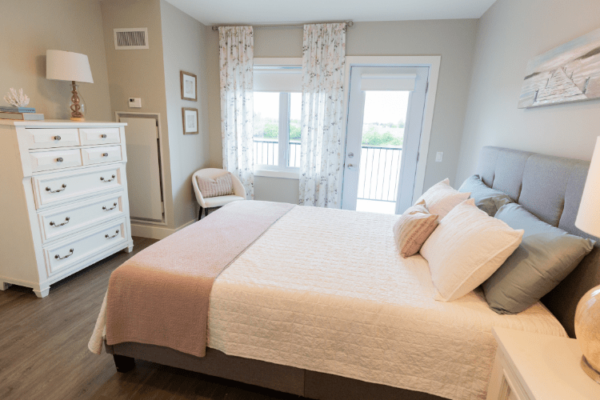 Bedroom model suite Aquatria Retirement Residence - Staging and Design by QC Design School graduate Chantal Marion