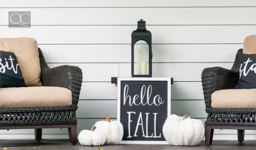 front porch decorating with hello fall chalkboard sign white pumpkins and chairs