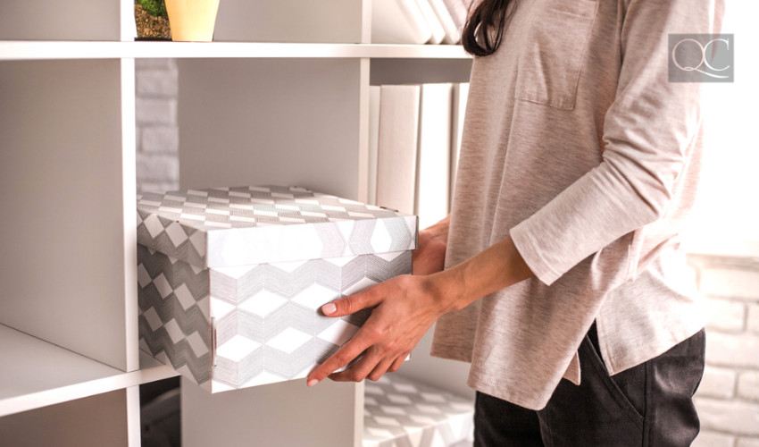putting box into a shelving unit organizer