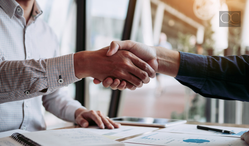 shaking hands with business owner professional organizer job
