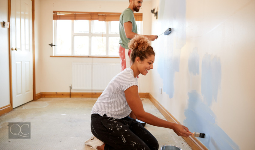 couple painting bedroom