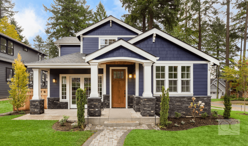 beautiful exterior of naval-colored house with great curb appeal