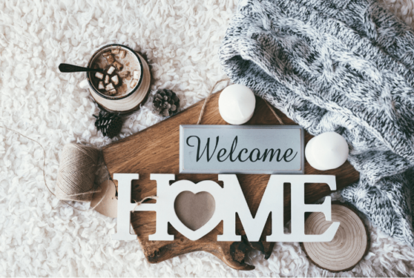 welcome home decor with blanket and head chocolate