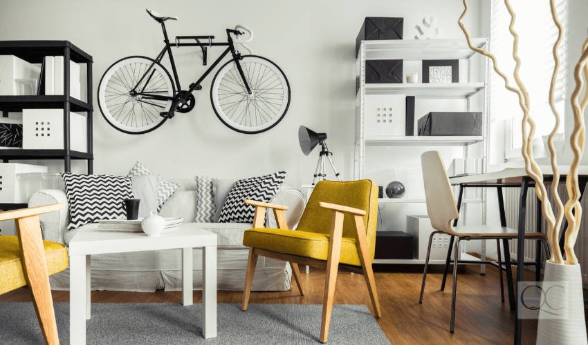 Interior of contemporary living room for hipster with bike mounted on wall
