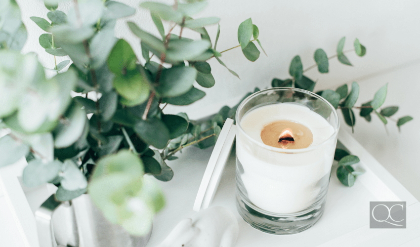 Natural eco home decor with green leaves and burning candle on it