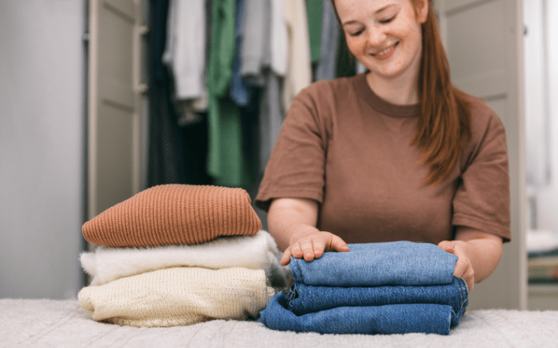 how to become a professional organizer - woman folding clothes