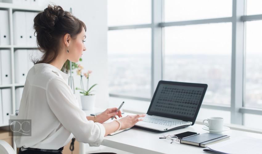 QC Design School Blog - Professional Organizer Working At Desk