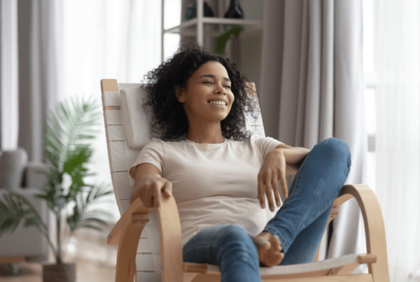 happy woman relaxing in feng shui-designed home