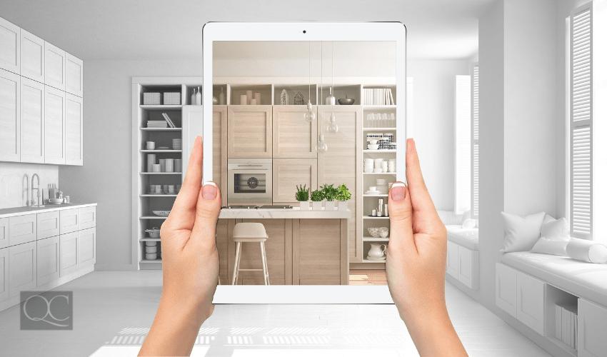 interior designer looking at living room space through ipad device