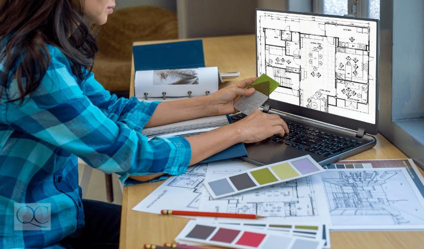 interior designer increasing salary by working online, off desktop computer
