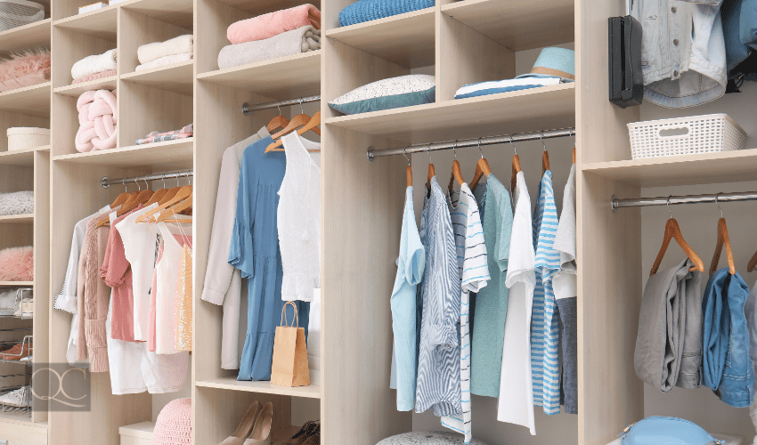 clothing closet organized by certified professional organizer