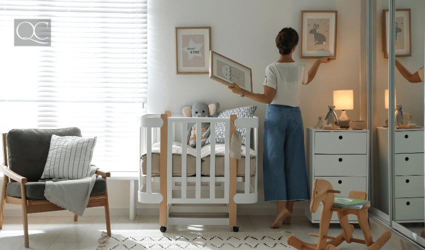 woman decorating baby nursery