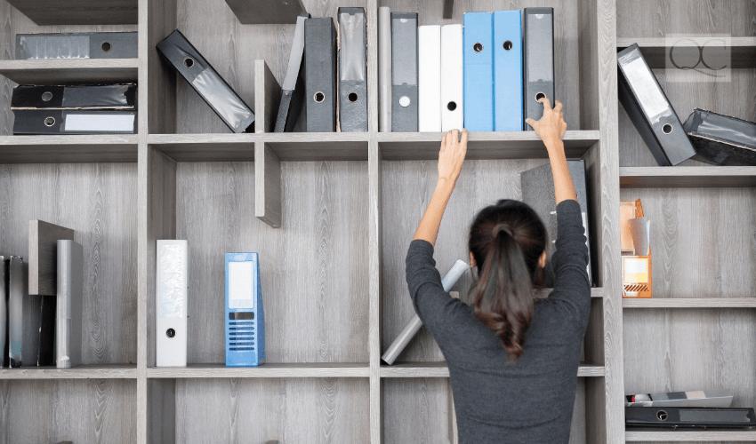 professional organizer organizing corporate bookshelf