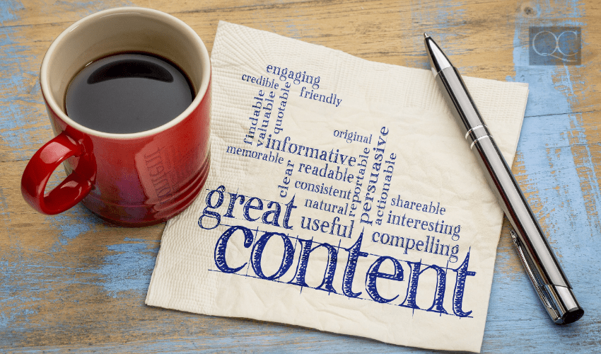 coffee mug and pen with napkin covered in content creation tips