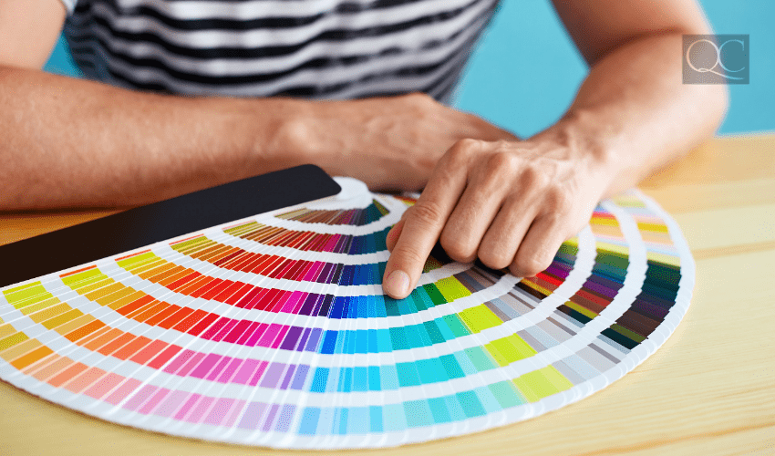 color consultant selecting colors off wheel