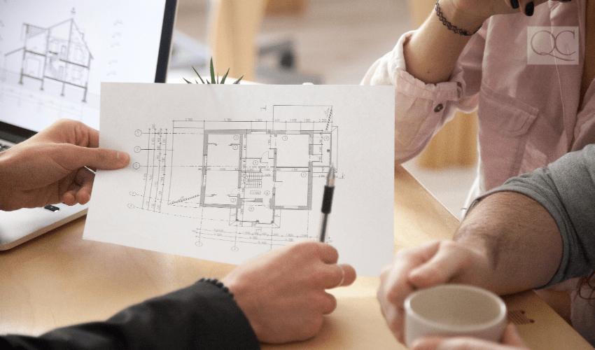 Feng Shui designer going over floor plan with clients