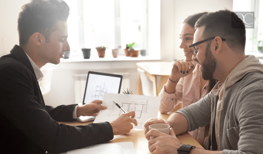 designer talking with clients at desk