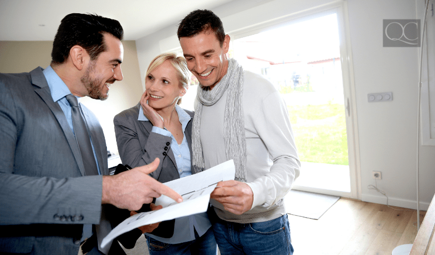prospective buyers seeing home with real estate agent